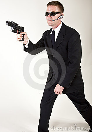 Secret Agent Pointing a Gun