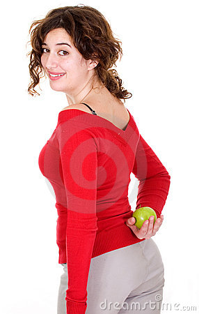 Secret diet - girl hiding an apple