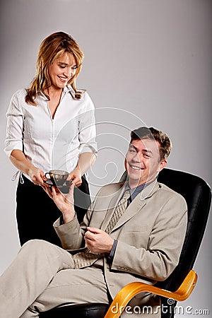 Secretary brings coffee for boss.