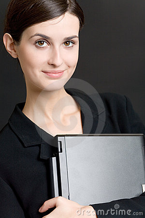Secretary or businesswoman in suit with notebook on blue background