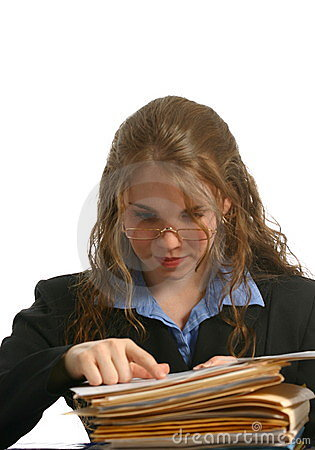 Secretary or businesswoman wearing glasses and looking at files