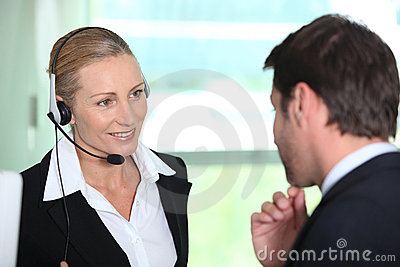Secretary giving information to boss