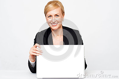 Secretary holding laptop flap, about to close