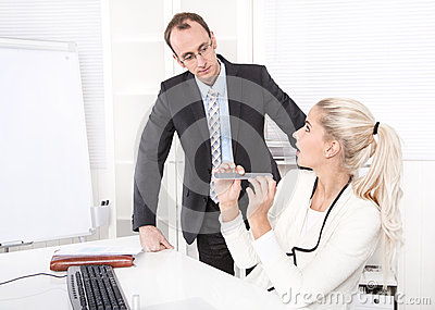 Secretary making manicure at office and surprised boss.
