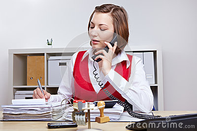 Secretary in office taking notes