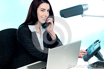 Secretary talking to client via phone call