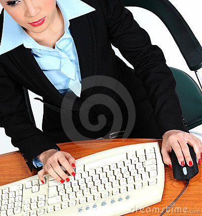 Secretary typing on a keyboard