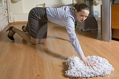Secretary washing the floor in office