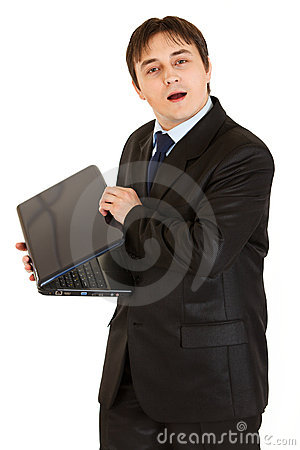 Secretive modern businessman hiding laptops screen