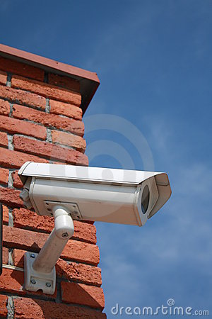 Security camera on the brick wall