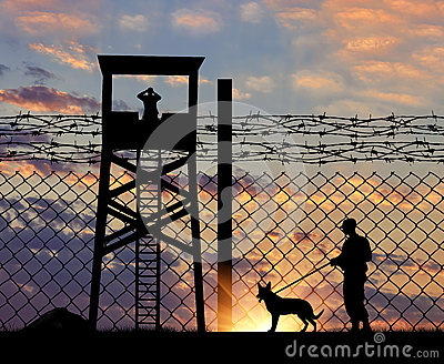 Security guard with dog on the border Stock Photo