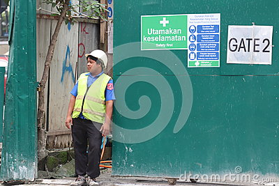 Security guard at the entrance of a construction site Editorial Stock Photo
