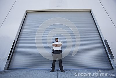 Security Guard Protects Warehouse Entrance