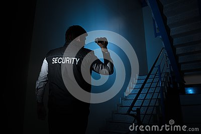Security Guard Standing Near Stairway Stock Photo