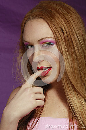 Seductive girl with multi colored makeup