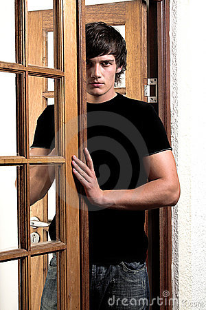 Seductive man in doorway