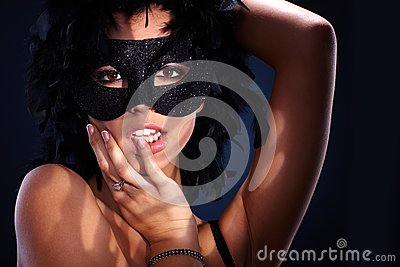Seductive portrait of woman in masquerade