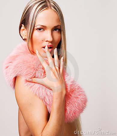 Seductive woman in a pink fur collar