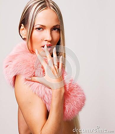 Seductive woman in a pink fur collar