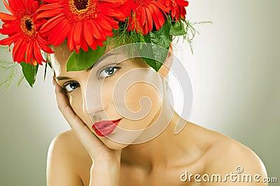 seductive woman wearing flowers in her hair