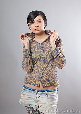 Seductive young woman in leopard shirt