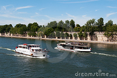 Seine river with tourists ship in Paris Editorial Stock Image