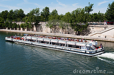 Seine river with tourists ship in Paris Editorial Photo