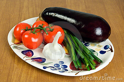Selection of fresh vegetables on a plate 1.