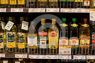 Selection of olive oil on the shelves in a supermarket Siam Paragon in Bangkok. Editorial Photography