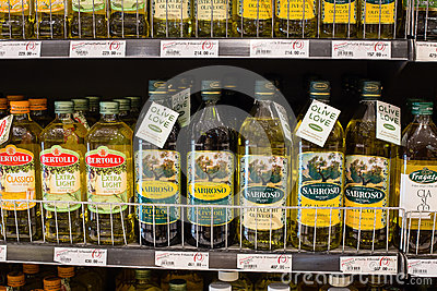 Selection of olive oil on the shelves in a supermarket Siam Paragon in Bangkok. Editorial Photo