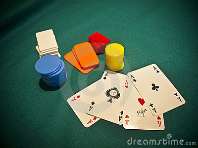 A selection of poker chips with 4 aces
