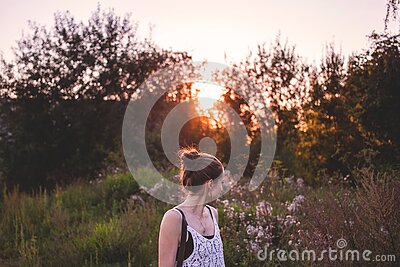 Selective Focus Photography Of Woman Standing In The Middle Of Grasses And Flowers During Golden Hour Free Public Domain Cc0 Image