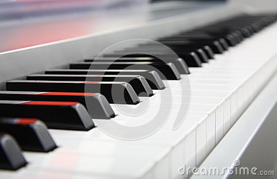 Selective focus of a piano keyboard closeup