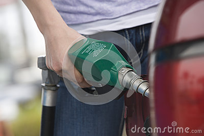 Selective Focus Of A Young Man Refueling His Car