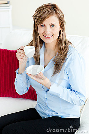 Self-assured blond businesswoman holding a cup