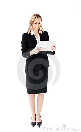 Self-assured businesswoman reading a newspaper