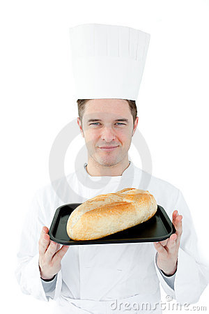 Self-assured chef holding a fresh bread