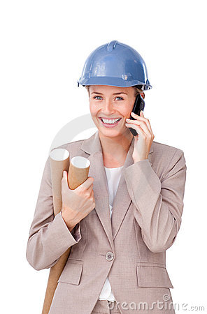 Self-assured female architect on phone standing