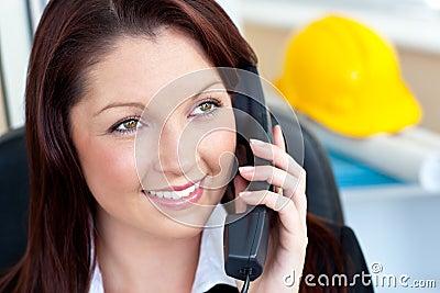 Self-assured female architecture talking on phone