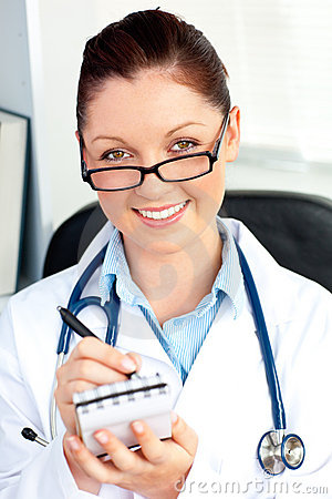 Self-assured female doctor holding a notepad