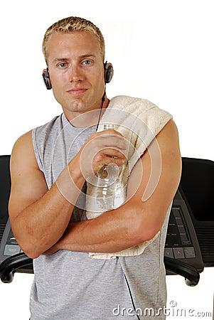 Self assured man leaning on a treadmill