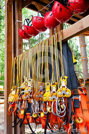 Free Self Belay Safety Equipment At A Ropes Course In A Treetop Adventure Park Stock Image - 136588841