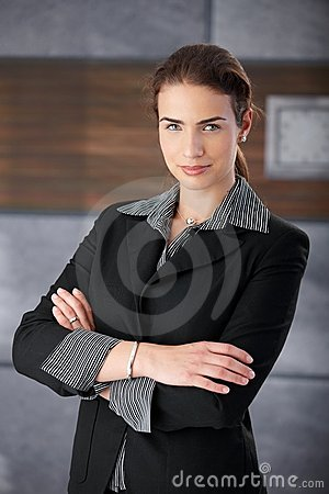 Self-confident businesswoman smiling arms crossed