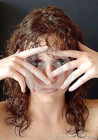 Self conscious girl hiding herself