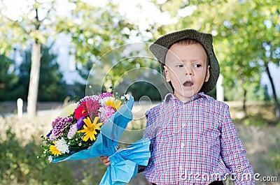 Self-conscious little boy singing