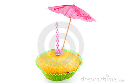 Selfmade muffin with umbrella and candle