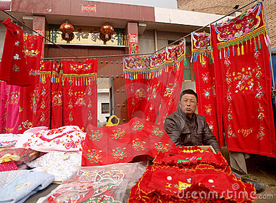 Sell cloth products of the male the shopkeeper