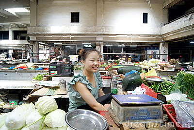Sell vegetables young woman Editorial Image