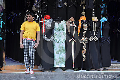 A seller of abaya in the market of Sharjah Editorial Stock Image
