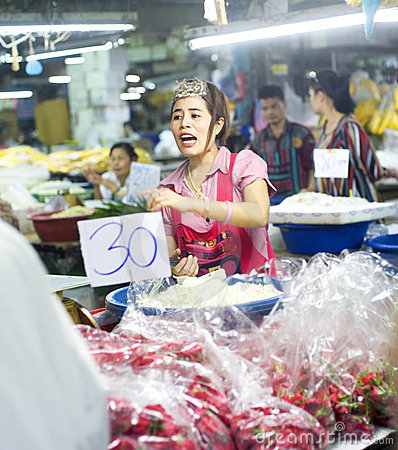 Seller at local market Editorial Photo